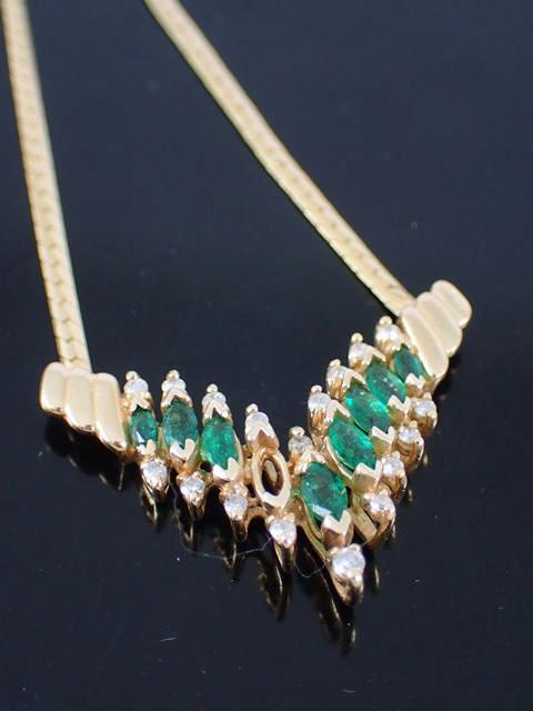 A 14ct gold diamond & gem set necklace approx. 9.25 grams