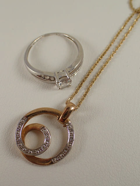 A 9ct gold diamond set pendant & chain & a 9ct gold gem set ring