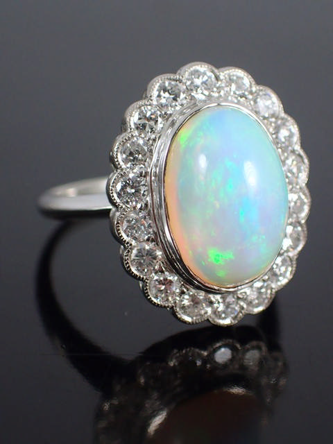 A opal & diamond cluster ring set in platinum