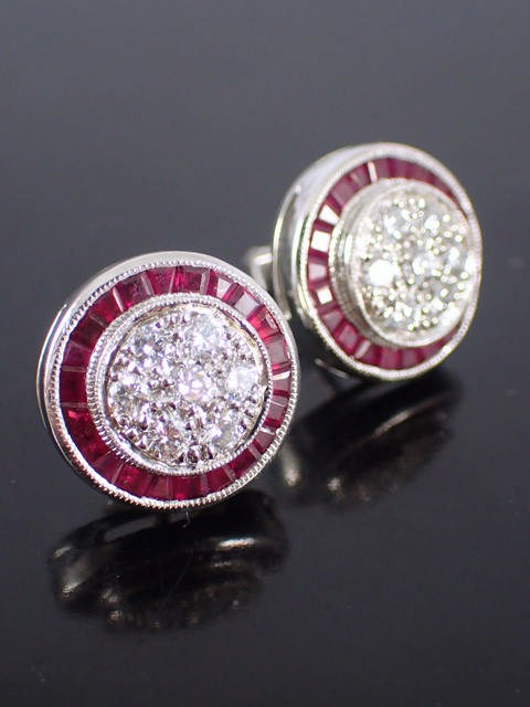 A pair of diamond & ruby earrings set in platinum