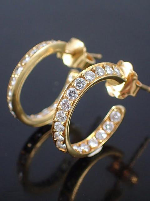 A pair of diamond set hoop earrings