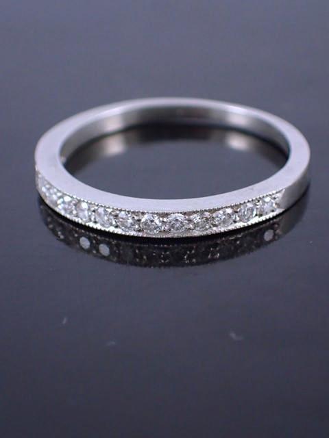 A platinum diamond half eternity ring