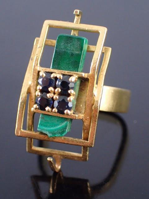 An 18ct gold gem set ring approx. 11 grams