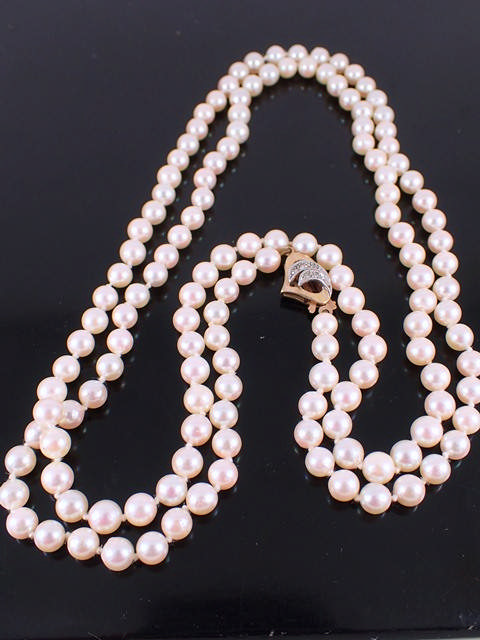 A string of pearls set with a diamond clasp