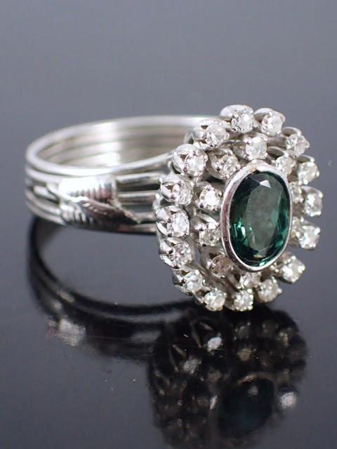 A diamond & gem set cluster ring