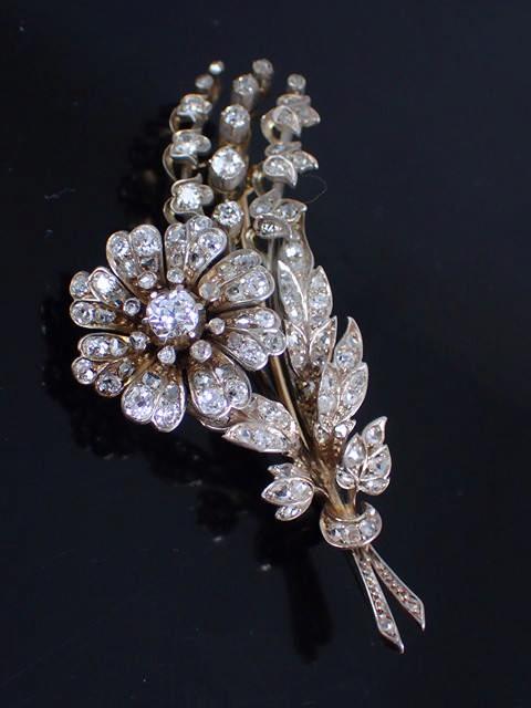An antique floral bouquet diamond brooch