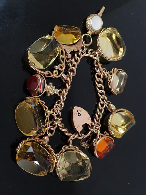 An antique gold bracelet set with various seals approx. 147 grams