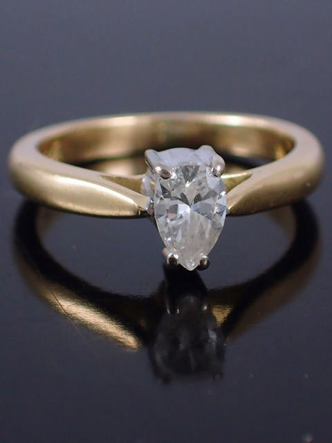 A pear shape diamond solitaire ring