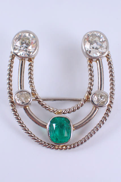 A fine diamond & emerald set brooch, this antique brooch is set with a Colombian emerald it is estim
