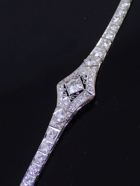 A fine diamond cluster bracelet set in platinum, total estimated weight of diamonds 5cts