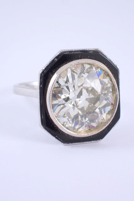 An important diamond & onxy set art deco style ring. The diamond is estimated at 8cts.The diamond is