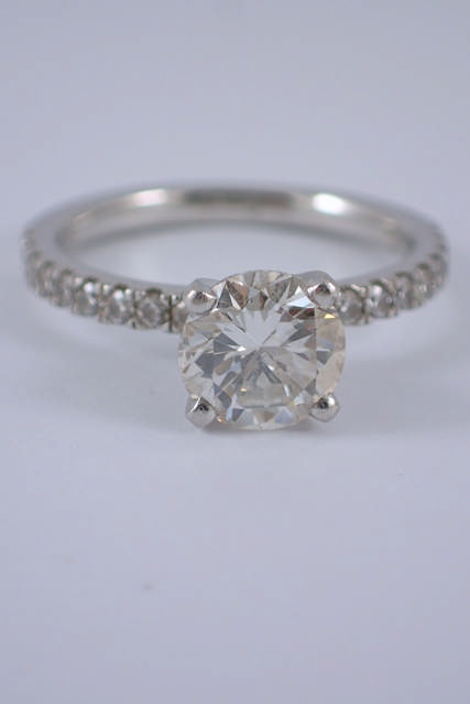 A fine diamond single stone ring set with diamond shoulders set in platinum, with a GIA certificate
