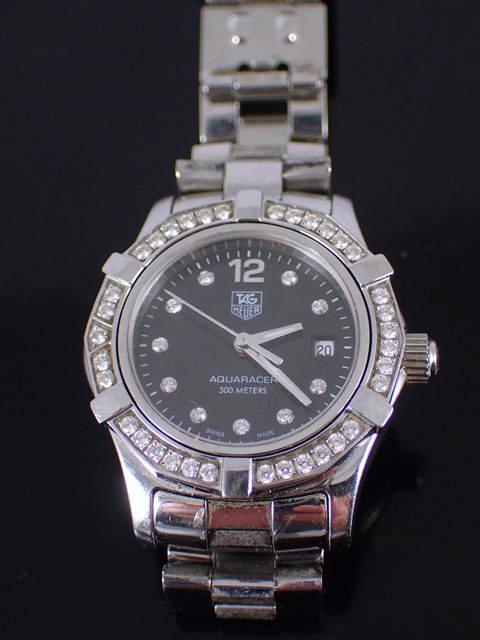 A diamond set lady's Tag Aquaracer wrist watch