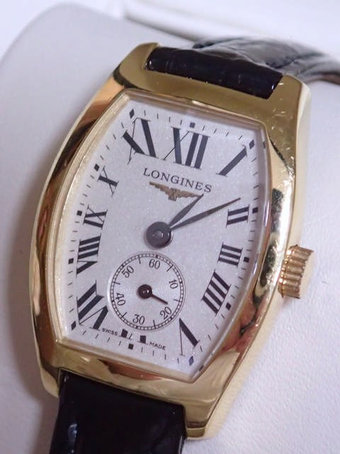 An 18ct gold Longines wrist watch in box with papers, purchased Jun '10