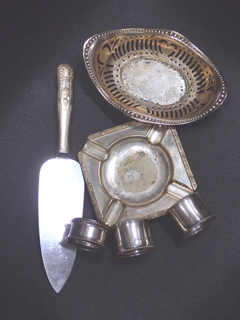 A collection of silver napkin rings & plated ware