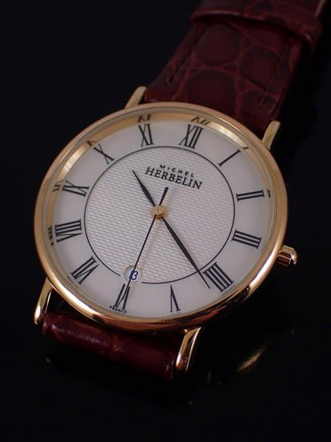 A gent's Michel Herbelin strap watch