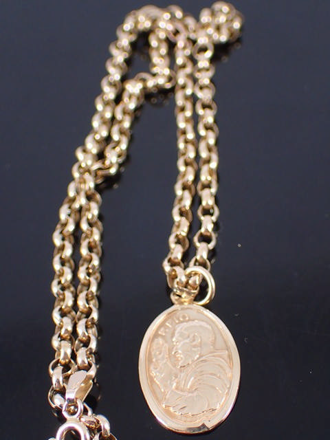 A 9ct gold Padre Pio medal & chain