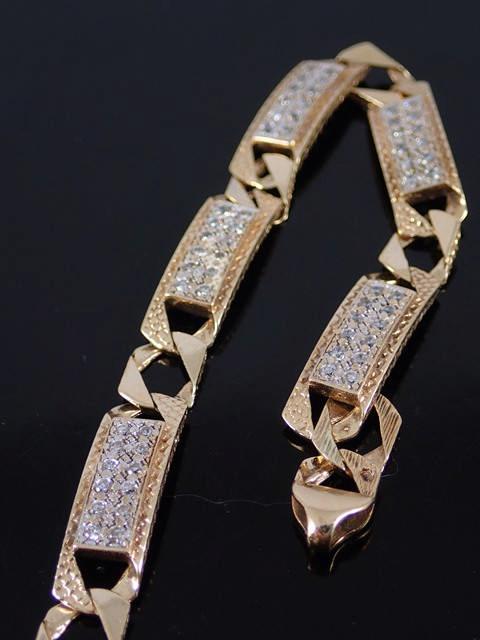A 9ct gold gem set bracelet