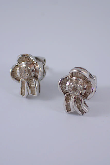 A pair of 14ct white gold diamond earrings