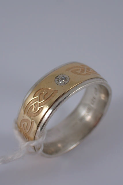 A 10ct gold & silver diamond ring
