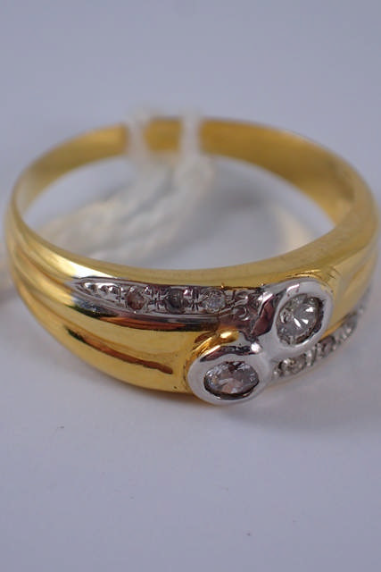 An 18ct gold two stone diamond ring