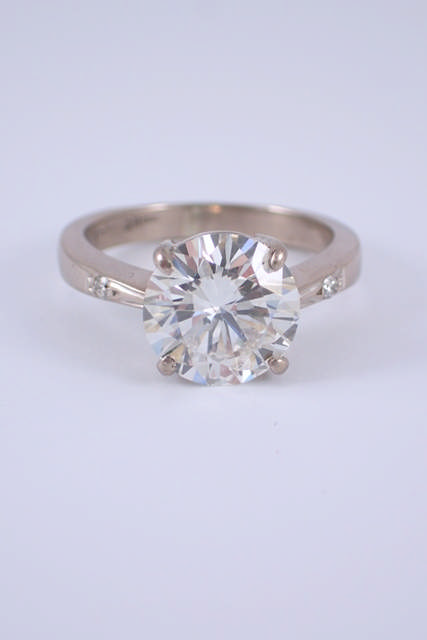 An 18ct white gold diamond solitaire ring with a valuation which states the diamond is 2.74cts I-J c