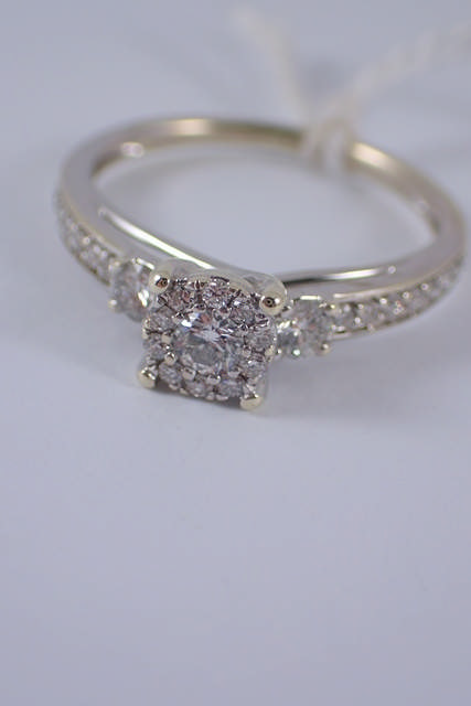 A 9ct white gold diamond cluster ring