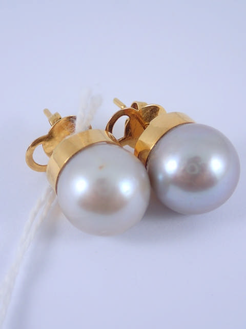 A pair of 18ct gold cultured pearl earrings