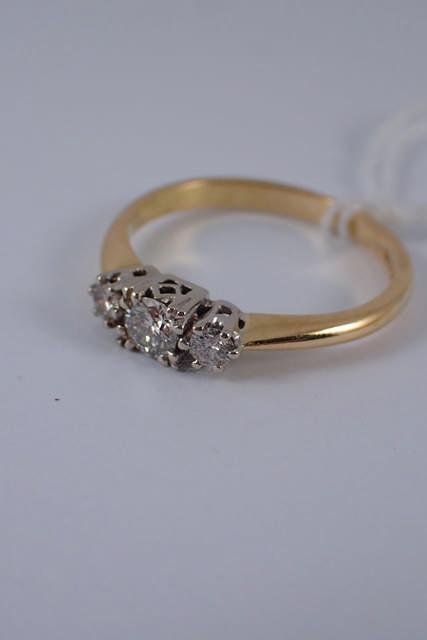 An 18ct gold three stone diamond ring