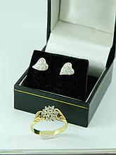 A pair of diamond earrings and a diamond ring