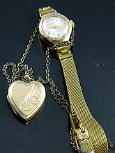 A gold watch & a heart locket