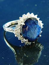 A fine sapphire & diamond cluster ring