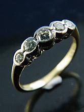 An 18ct gold five stone diamond ring