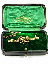 An antique gem set brooch in box