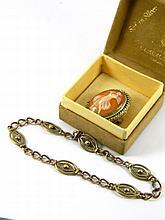 A brooch & a bracelet