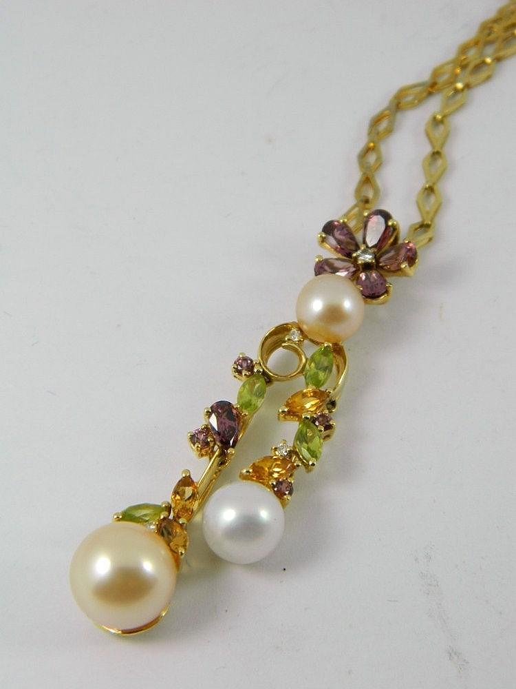 A diamond, pearl & gem set necklace