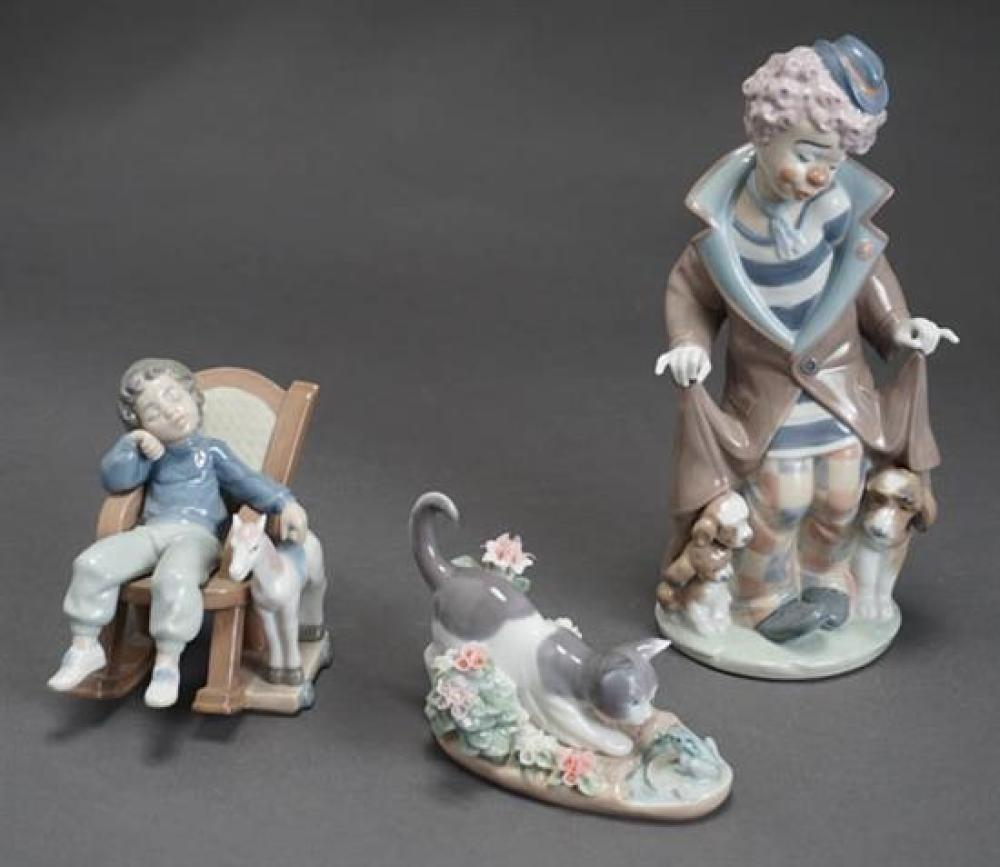 Three Lladró Figures of 'Surprise', 'Kitty's Confrontation' and 'All Tuckered Out' Post 1950