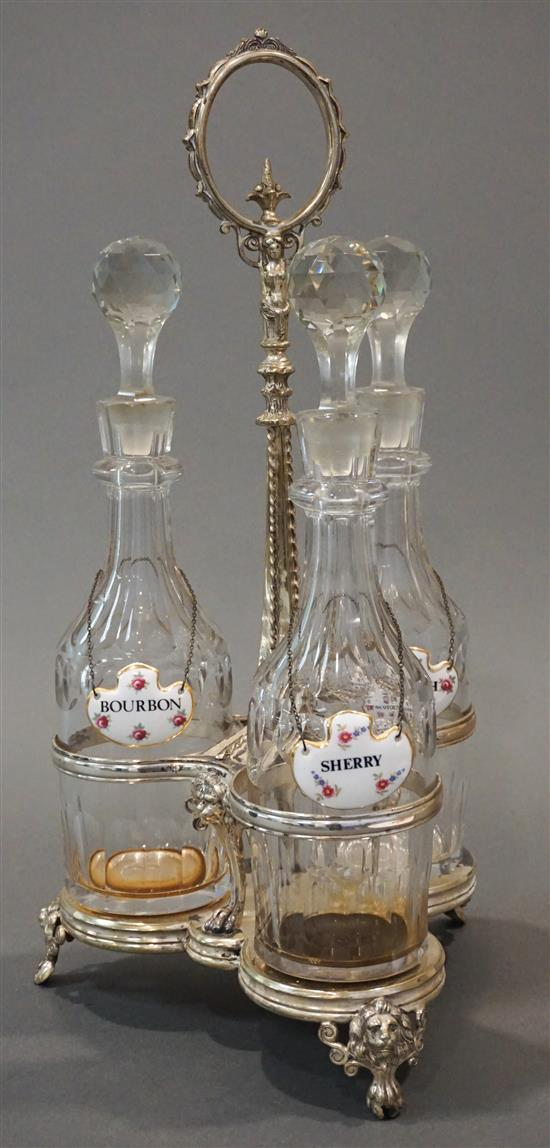 Three Crystal Decanters in a Silverplate Stand