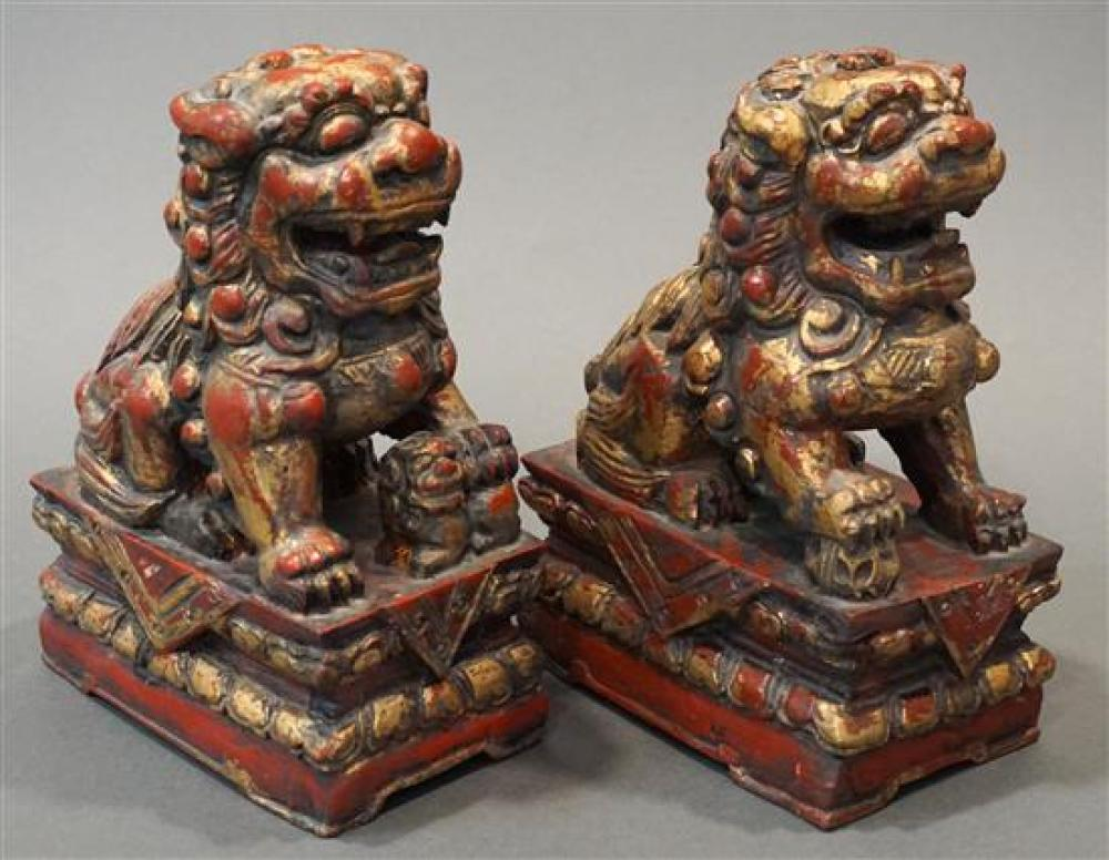 Pair of Parcel Gilt and Red Painted Foo Lions, H: 10-1/2 in