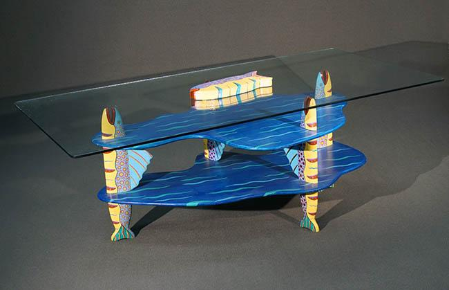 Tom Dolan Painted and Decorated Wood Two Tier 'Speckled Fish' Glass Top Dining Table; together with 'Speckled Fish' Hinged Puzzle B