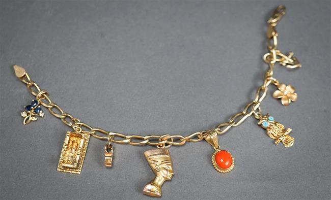 14-Karat Yellow-Gold Charm Bracelet with Eight Gold Charms and One Gold-Filled 'Pharoah' Charm, 10.8 gross dwt
