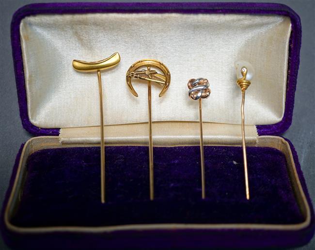 Four Early 20th Century 14-Karat Yellow-Gold Stickpins, 4.9 gross dwt.