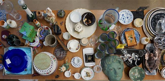 Table Lot with Glass, Two South American Wall Hangings and Pottery