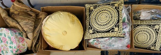 Four Boxes with Throw Pillows and Table Linens