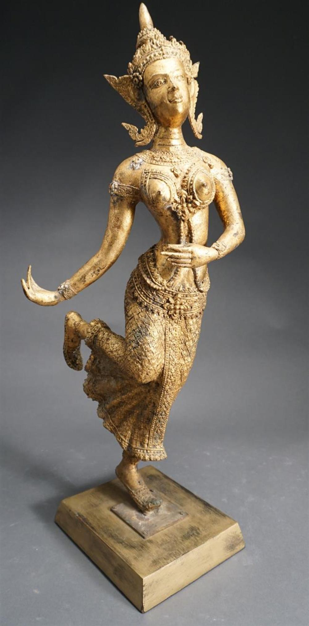 Thai Gilt Painted Metal Figure of a Dancing Deity on Wood Stand, Height: 27 in