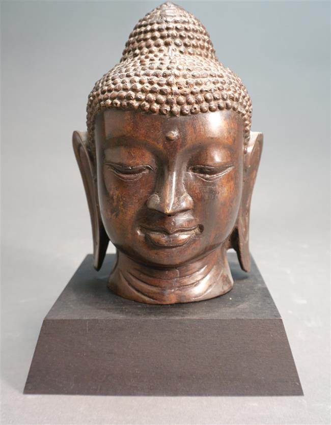 Thai Patinated Metal Bust of a Buddha on Ebonized Wood Stand, Height Overall: 10-1/4 in