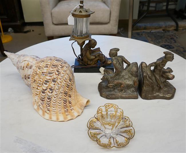 Pair of Patinated Metal Bookends, Seashell, Glass Teacup and Saucer and a Figural Table Lamp