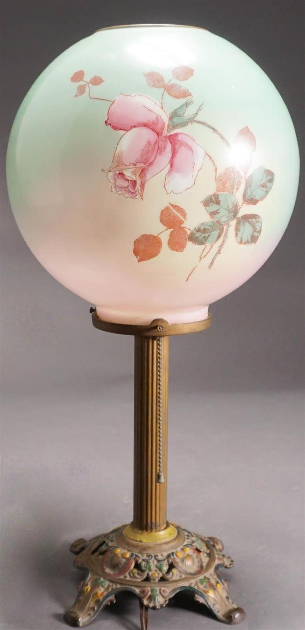 Polychrome Decorated Patinated Metal Base Floral Decorated Glass Table Lamp, H: 21 inches