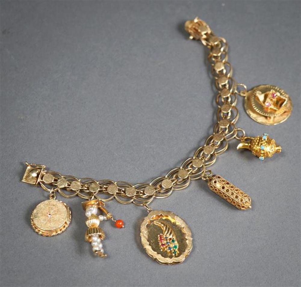 14-Karat Yellow-Gold Bracelet with Six 14-Karat Gold Charms, L: 7-1/4 inches; 27.2 gross dwt.