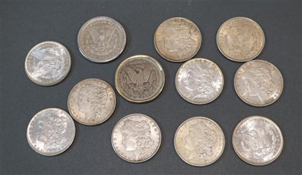 Collection of Twelve U.S. Morgan Silver Dollars (2 in bezels)